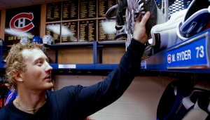 Photo of Michael Ryder hanging up his skates after Bell Centre practice Oct. 22, 2003. Photo by Dave Sidaway.